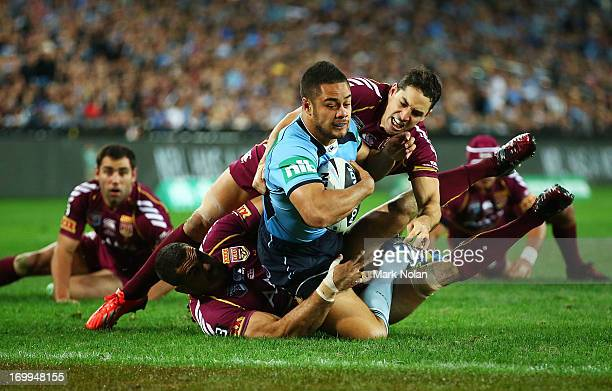 Jarryd Hayne of the Blues heads for the try line to score during game one of the ARL State of Origin series between the New South Wales Blues and the...