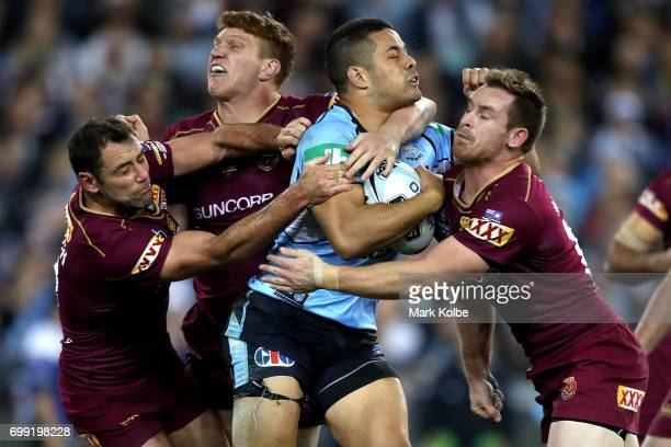 Jarryd Hayne of the Blues is tackled during game two of the State Of Origin series between the New South Wales Blues and the Queensland Maroons at...
