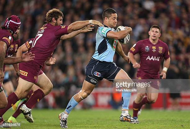 Jarryd Hayne of the Blues makes a break during game three of the State of Origin series between the Queensland Maroons and the New South Wales Blues...