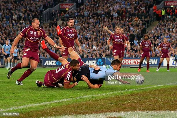 Jarryd Hayne of the Blues scores a try during game one of the ARL State of Origin series between the New South Wales Blues and the Queensland Maroons...