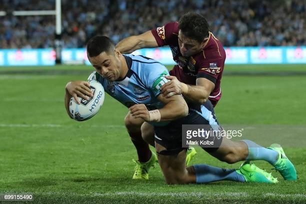 Jarryd Hayne of the Blues scores a try during game two of the State Of Origin series between the New South Wales Blues and the Queensland Maroons at...