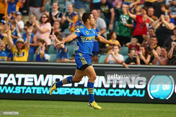 Jarryd Hayne of the Eels celebrates scoring a try during the round one NRL match between the Parramatta Eels and the Warriors at Parramatta Stadium...
