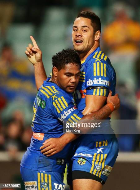 Jarryd Hayne of the Eels celebrates with Chris Sandow after scoring a try during the round nine NRL match between the Parramatta Eels and the...