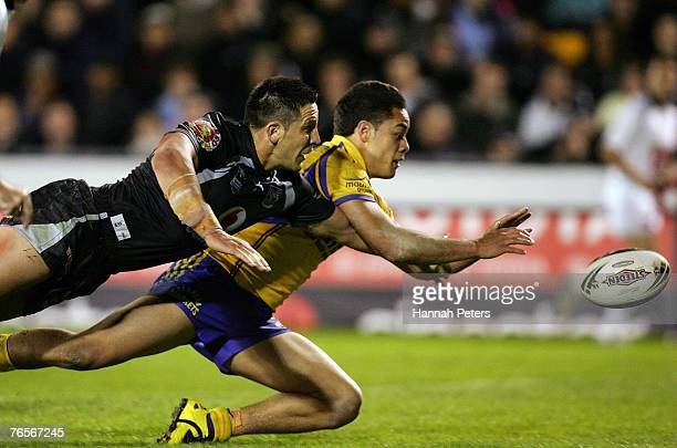 Jarryd Hayne of the Eels dives into score as Steve Price tries to knock the ball out during the NRL qualifying final match between the Warriors and...