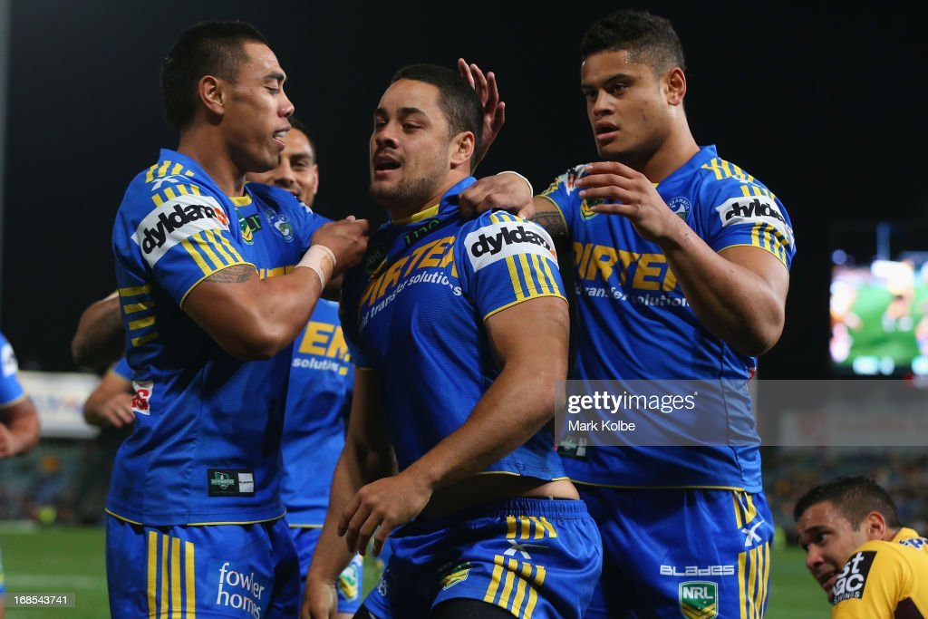 <a gi-track='captionPersonalityLinkClicked' href=/galleries/search?phrase=Jarryd+Hayne&family=editorial&specificpeople=563352 ng-click='$event.stopPropagation()'>Jarryd Hayne</a> of the Eels is congratulated by his team mates after scoring a goal during the round nine NRL match between the Parramatta Eels and the Brisbane Broncos at Parramatta Stadium on May 11, 2013 in Sydney, Australia.