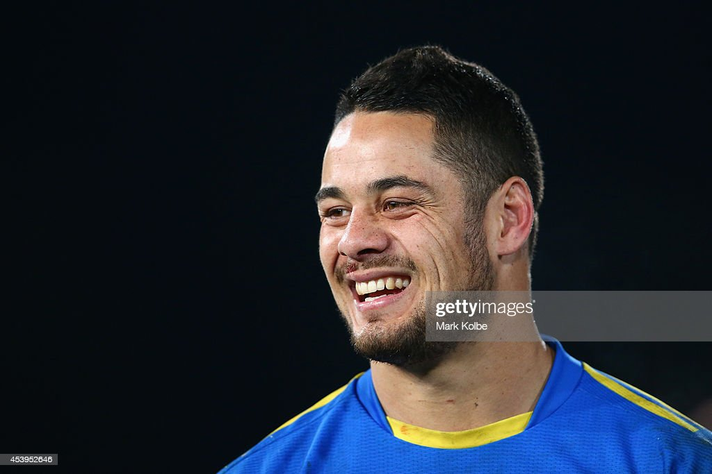 Jarryd Hayne of the Eels laughs as he watches on during the post game farewells after the round 24 NRL match between the Parramatta Eels and the Manly Sea Eagles at Pirtek Stadium on August 22, 2014 in Sydney, Australia.