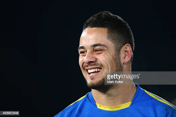 Jarryd Hayne of the Eels laughs as he watches on during the post game farewells after the round 24 NRL match between the Parramatta Eels and the...