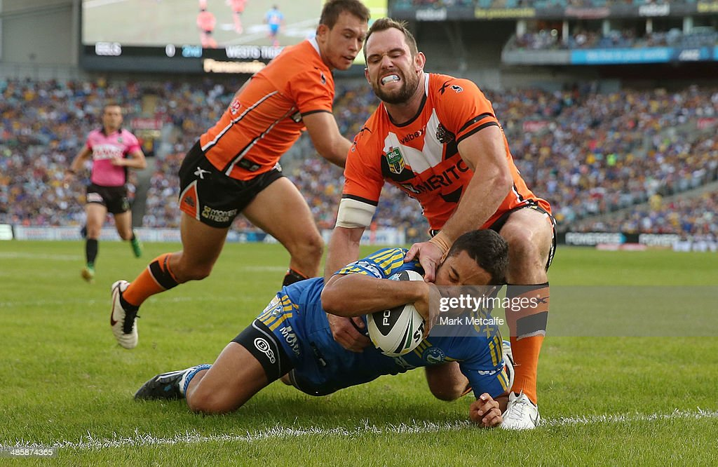 Jarryd Hayne of the Eels scores a try during the round seven NRL match between the Parramatta Eels and the Wests Tigers at ANZ Stadium on April 21, 2014 in Sydney, Australia.