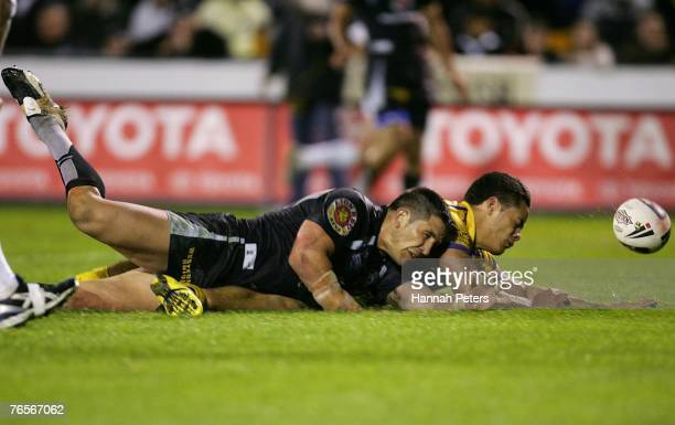 Jarryd Hayne of the Eels scores as Steve Price tries to knock the ball out during the NRL qualifying final match between the Warriors and the...