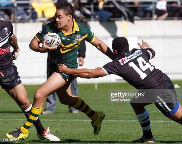 Jarryd Hayne of the Kangaroos fends off David Faiumu of the Kiwis during the Centennial Test match between the New Zealand Kiwis and the Australian...
