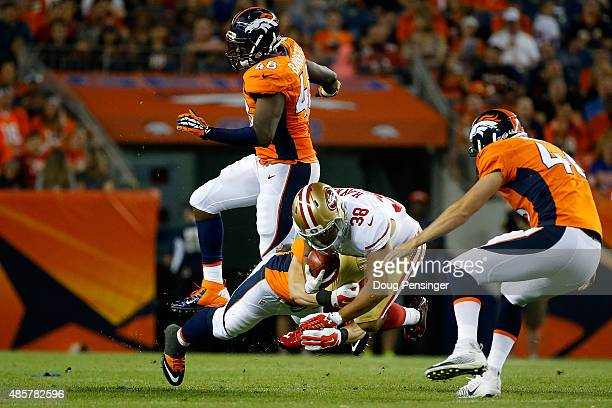 Jarryd Hayne of the San Francisco 49ers makes a punt return and is tackled by Joe Don Duncan of the Denver Broncos during preseason action at Sports...
