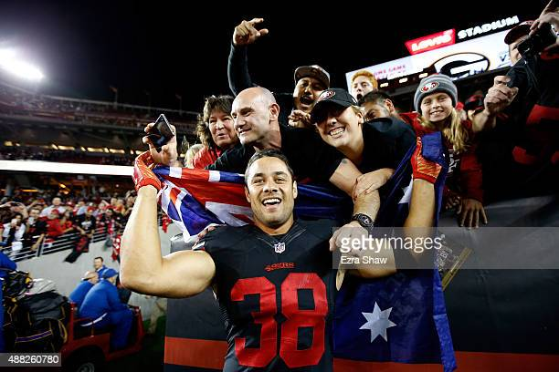 Jarryd Hayne of the San Francisco 49ers poses with fans after the 49ers beat the Minnesota Vikings in their NFL game at Levi's Stadium on September...