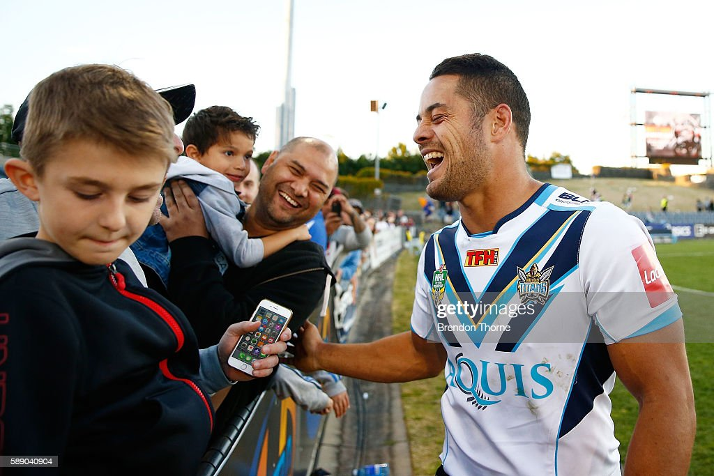 Jarryd Hayne of the Titans celebrates with fans following the round 23 NRL match between the Wests Tigers and the Gold Coast Titans at Campbelltown...