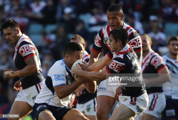 Jarryd Hayne of the Titans fights for the ball with Connor Watson of the Roosters during the round 26 NRL match between the Sydney Roosters and the...