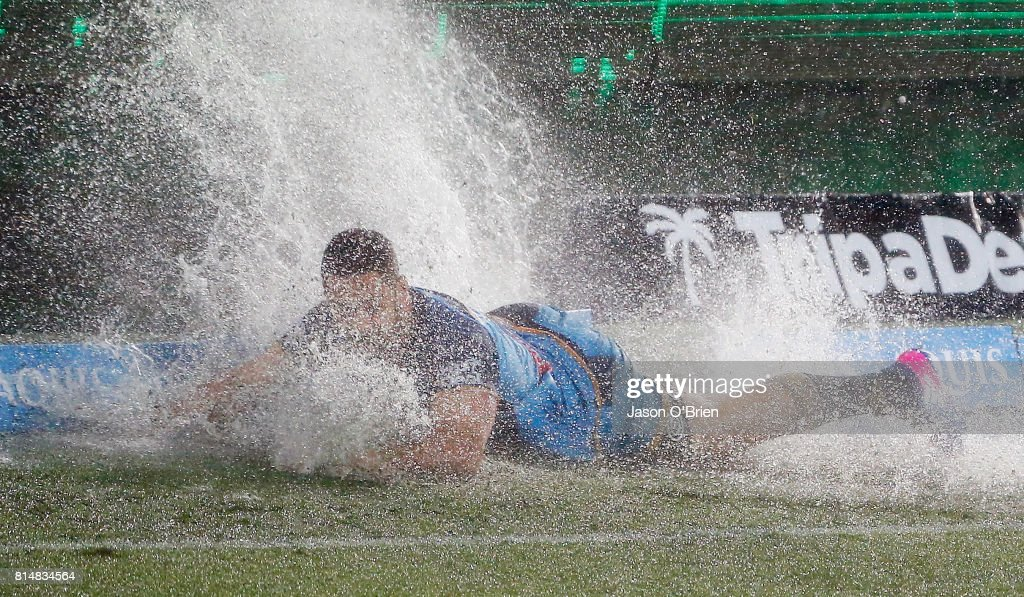 Jarryd Hayne of the Titans hits a puddle of water during the round 19 NRL match between the Gold Coast Titans and the Cronulla Sharks at Cbus Super Stadium on July 15, 2017 in Gold Coast, Australia.
