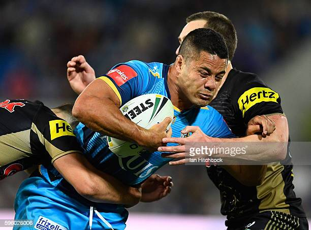 Jarryd Hayne of the Titans is tackled by Isaah Yeo of the Panthers during the round 25 NRL match between the Gold Coast Titans and the Penrith...