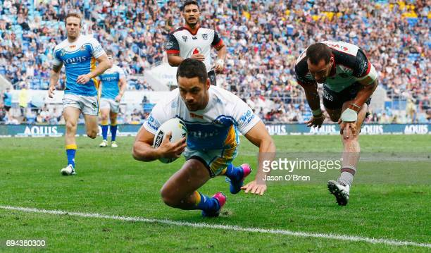 Jarryd Hayne of the Titans scores a try during the round 14 NRL match between the Gold Coast Titans and the New Zealand Warriors at Cbus Super...
