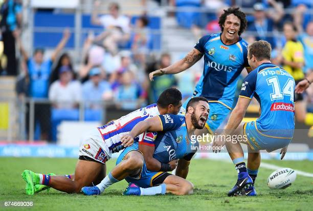 Jarryd Hayne of the Titans scores a try during the round nine NRL match between the Gold Coast Titans and the Newcastle Knights at Cbus Super Stadium...