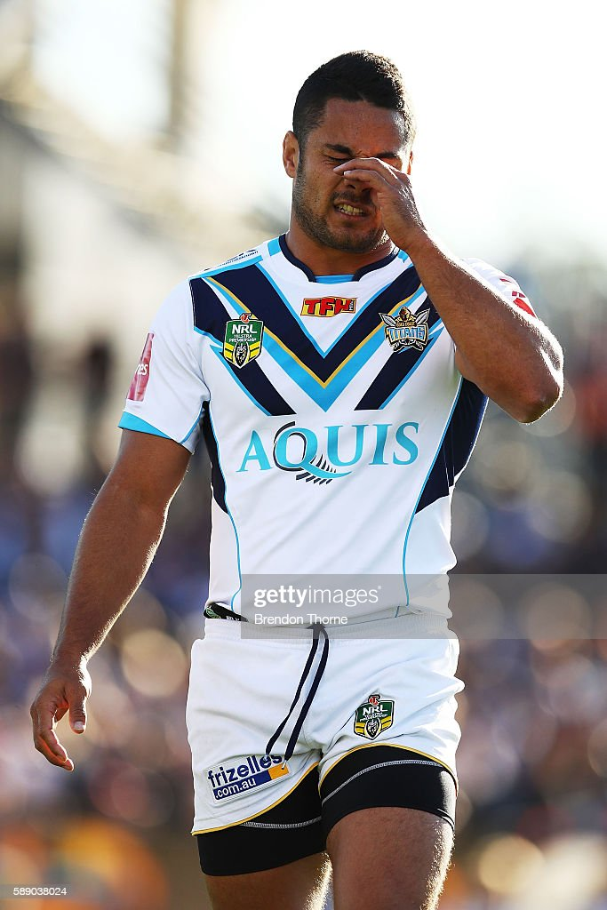 Jarryd Hayne of the Titans shows signs of dejection during the round 23 NRL match between the Wests Tigers and the Gold Coast Titans at Campbelltown...