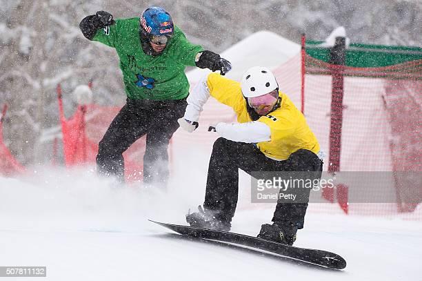 Jarryd Hughes leads Alex Pullin during the men's boardercross final at Winter X Games 2016 Aspen at Buttermilk Mountain on January 31 in Aspen...
