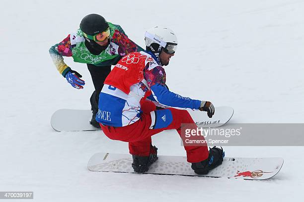 Jarryd Hughes of Australia and Pierre Vaultier of France compete in the Men's Snowboard Cross 1/8 Finals on day eleven of the 2014 Winter Olympics at...