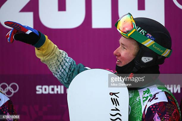 Jarryd Hughes of Australia celebrates after his heat in the Men's Snowboard Cross 1/8 Finals on day eleven of the 2014 Winter Olympics at Rosa Khutor...