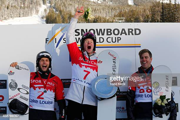 Jarryd Hughes of Australia celebrates his win with Konstantin Schad of Great Britain who finished second and Alex Deibold of the US who finished...