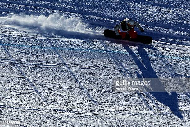 Jarryd Hughes of Australia competes in the Snowboard Cross Qualification during day seven of the Winter Games NZ at Cardrona Alpine Resort on August...