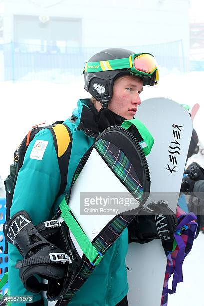 Jarryd Hughes of Australia leaves Stadium PSX as competition is postponed due to bad weather conditions in the Men's Snowboard Cross on day ten of...