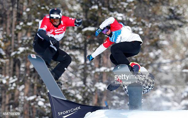 Jarryd Hughes of Australia races Konstantin Schad of Great Britain with Nick Baumgartner of the US following behind during the men's semifinals at...