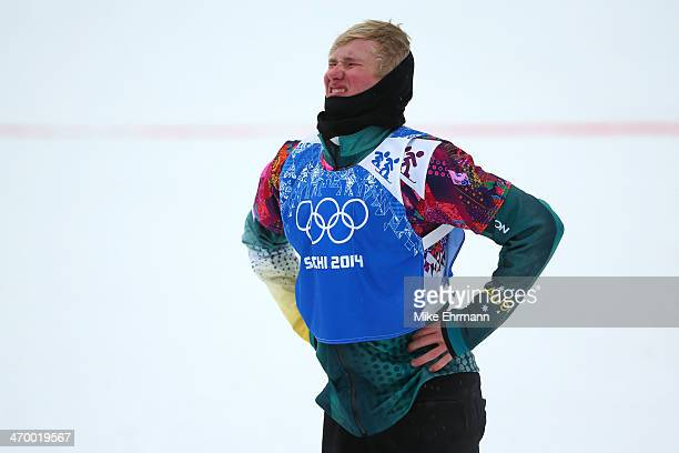 Jarryd Hughes of Australia reacts after his heat in the Men's Snowboard Cross Quarterfinals on day eleven of the 2014 Winter Olympics at Rosa Khutor...