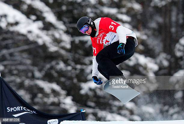 Jarryd Hughes of Australia takes to the air during the men's qualification run at the FIS Snowboard Cross World Cup December 20 2013 in Lake Louise...