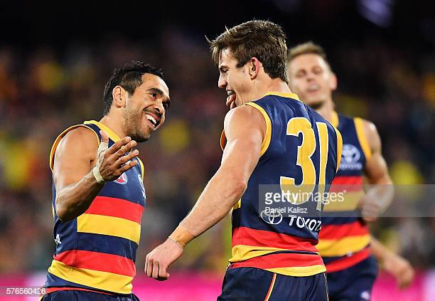 Jarryd Lyons of the Crows is congratulated by Eddie Betts of the Crows after kicking a goal during the round 17 AFL match between the Adelaide Crows...
