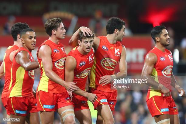 Jarryd Lyons of the Suns celebrates a goal during the round seven AFL match between the Gold Coast Suns and the Geelong Cats at Metricon Stadium on...