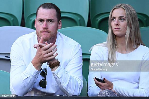 Jarryd Roughead and Sarah Dunn watch the semifinal match between Roger Federer of Switzerland and Stan Wawrinka of Switzerland on day 11 of the 2017...