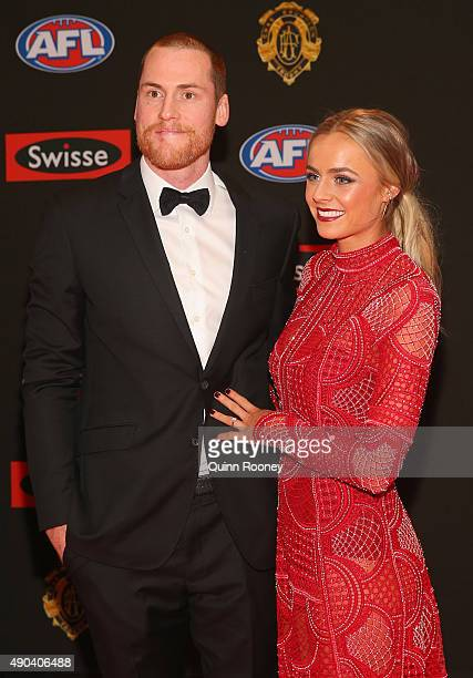Jarryd Roughead of Hawthorn and his partner Sarah Dunn arrives at the 2015 Brownlow Medal at Crown Palladium on September 28 2015 in Melbourne...