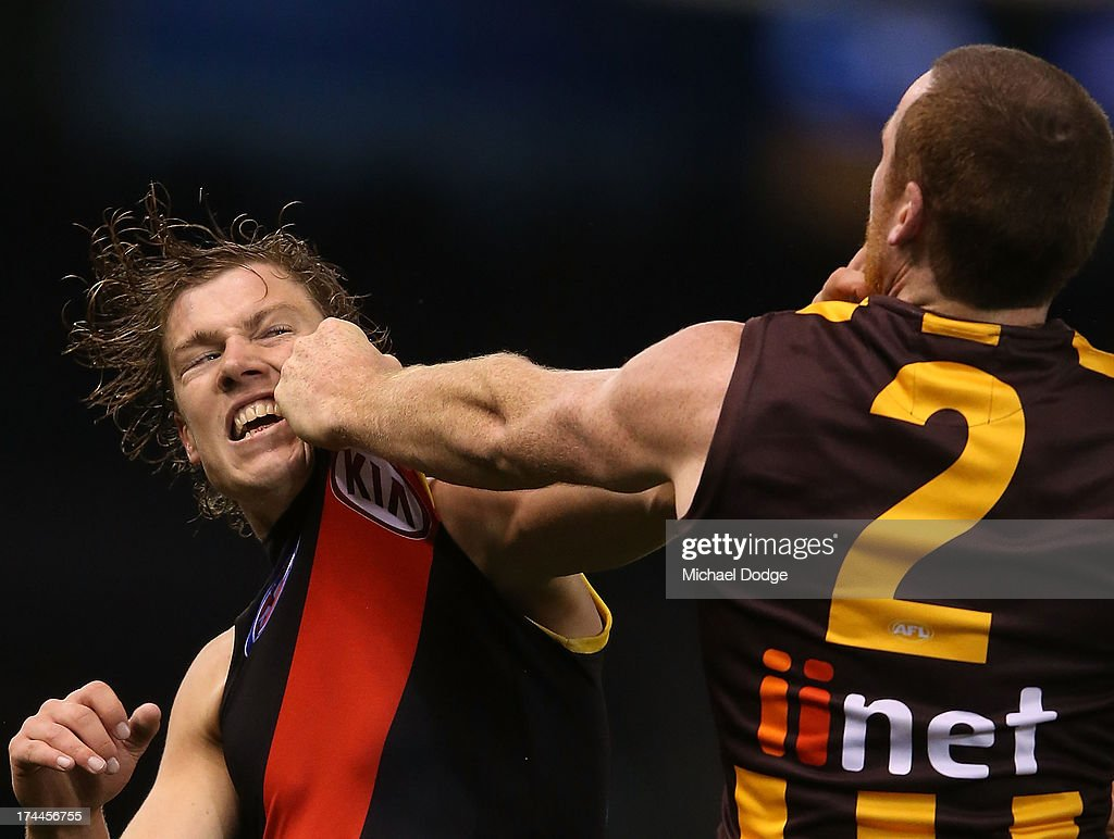 <a gi-track='captionPersonalityLinkClicked' href=/galleries/search?phrase=Jarryd+Roughead&family=editorial&specificpeople=227104 ng-click='$event.stopPropagation()'>Jarryd Roughead</a> (R) of the Hawks and Jake Melskham of the Bombers fight behind play during the round 18 AFL match between the Essendon Bombers and the Hawthorn Hawks at Etihad Stadium on July 26, 2013 in Melbourne, Australia.