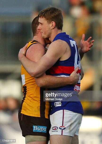 Jarryd Roughead of the Hawks and Jordan Roughead of the Bulldogs hug after the round 17 AFL match between the Hawthorn Hawks and the Western Bulldogs...