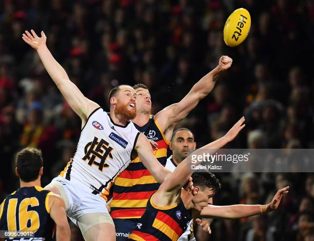 Jarryd Roughead of the Hawks and Josh Jenkins of the Crows compete for the ball during the round 14 AFL match between the Adelaide Crows and the...
