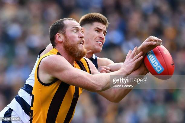 Jarryd Roughead of the Hawks and Zac Smith of the Cats compete for a mark during the round 17 AFL match between the Geelong Cats and the Hawthorn...