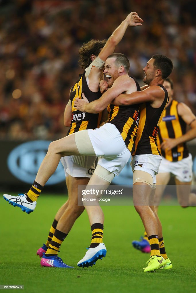 Jarryd Roughead of the Hawks (C) celebrates a goal with Ty Vickery (L) and Jack Gunston during the round one AFL match between the Essendon Bombers and the Hawthorn Hawks at Melbourne Cricket Ground on March 25, 2017 in Melbourne, Australia.