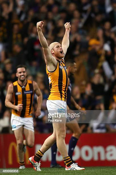 Jarryd Roughead of the Hawks celebrates after kicking a goal during the AFL First Preliminary Final match between the Fremantle Dockers and the...