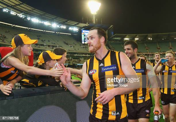 Jarryd Roughead of the Hawks celebrates the win with fans during the round five AFL match between the Hawthorn Hawks and the West Coast Eagles at...