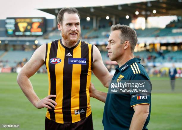 Jarryd Roughead of the Hawks chats to Alastair Clarkson Senior Coach of the Hawks during the 2017 AFL round 08 match between the Hawthorn Hawks and...