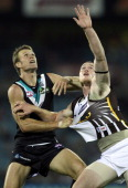 Jarryd Roughead of the Hawks competes for the ball over Dean Brogan of the Power during the round seven AFL match between Port Adelaide Power and the...