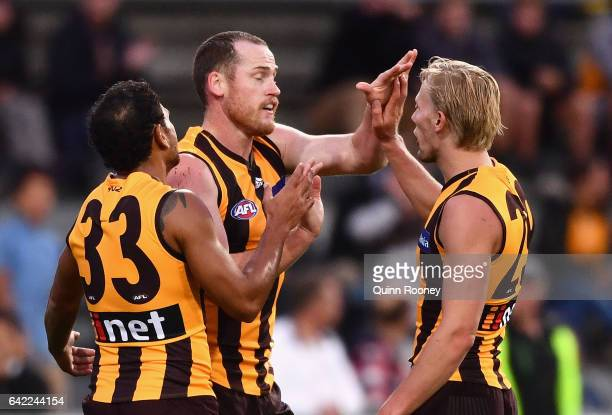 Jarryd Roughead of the Hawks is congratulated by team mates after kicking a goal during the 2017 JLT Community Series match between the Hawthorn...