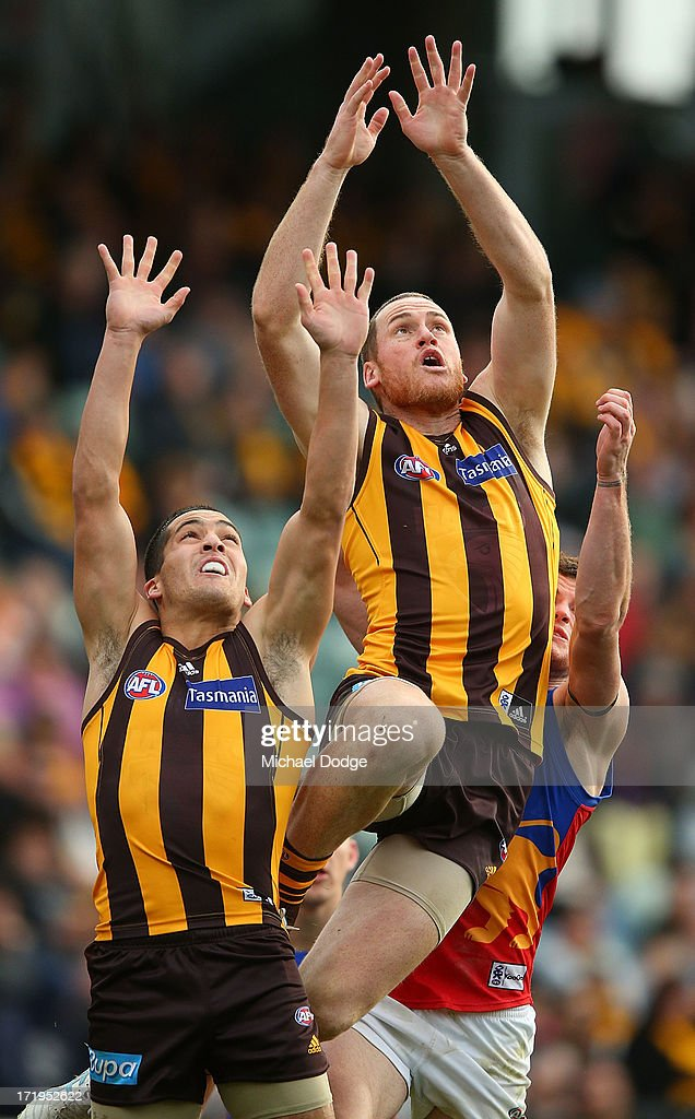 <a gi-track='captionPersonalityLinkClicked' href=/galleries/search?phrase=Jarryd+Roughead&family=editorial&specificpeople=227104 ng-click='$event.stopPropagation()'>Jarryd Roughead</a> of the Hawks jumps high for a mark during the round 14 AFL match between the Hawthorn Hawks and the Brisbane Lions at Aurora Stadium on June 30, 2013 in Launceston, Australia.