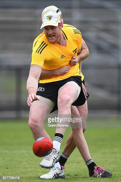 Jarryd Roughead of the Hawks kicks whilst being tackled during a Hawthorn Hawks AFL preseason training session at Waverley Park on December 5 2016 in...
