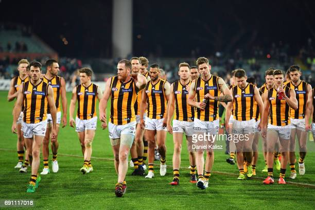 Jarryd Roughead of the Hawks leads his team from the ground after being defeated during the round 11 AFL match between the Port Adelaide Power and...