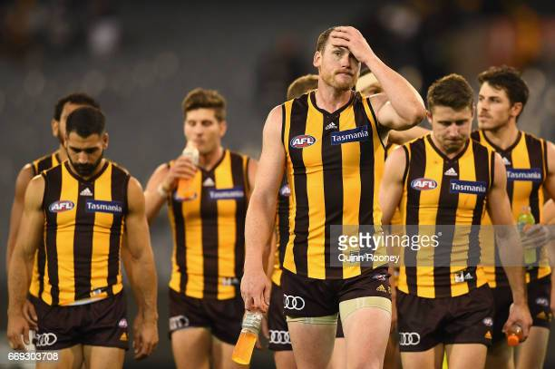 Jarryd Roughead of the Hawks looks dejected as he leads his team off the field after losing the round four AFL match between the Hawthorn Hawks and...